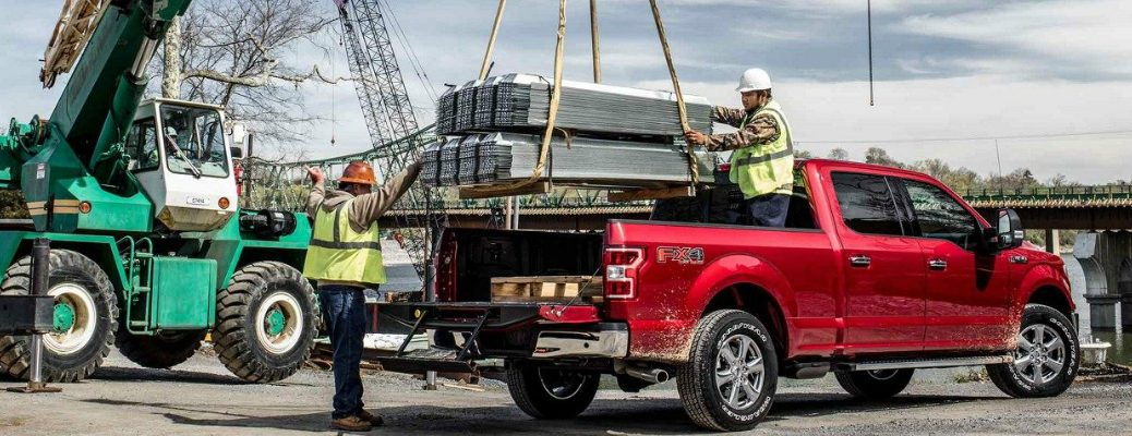 Workers Loading up the Bed of a 2018 Ford F-150