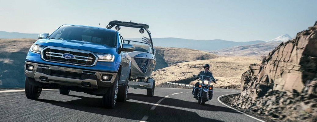 2019 Ford Ranger Driving Next to a Motorcycle