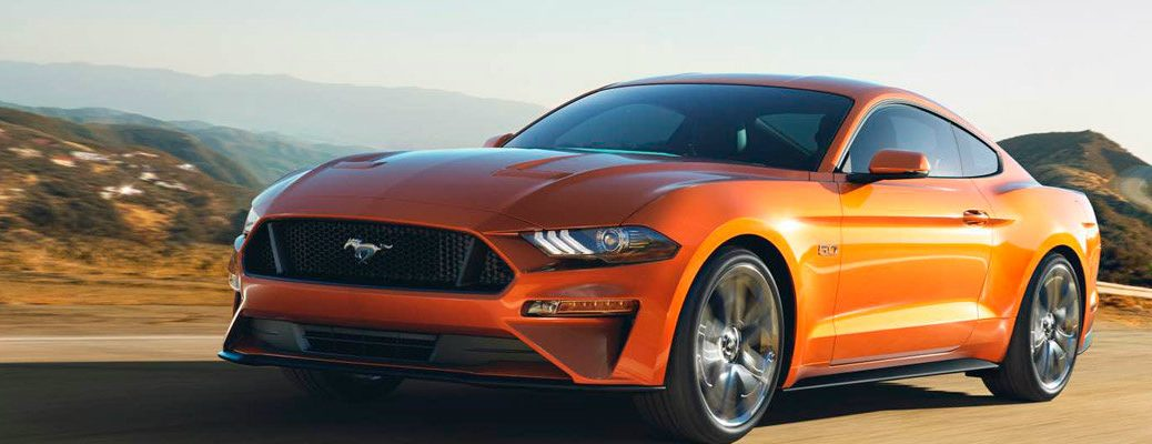 Orange 2018 Ford Mustang Driving on Highway