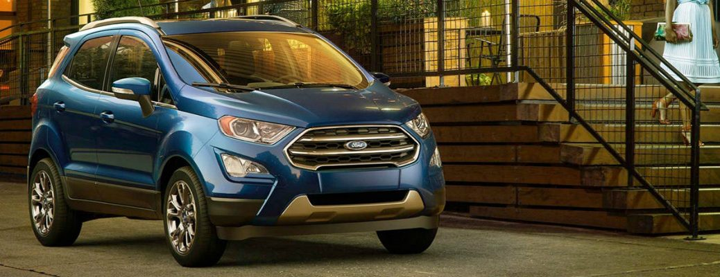 Blue 2018 Ford EcoSport parked in front of building railing