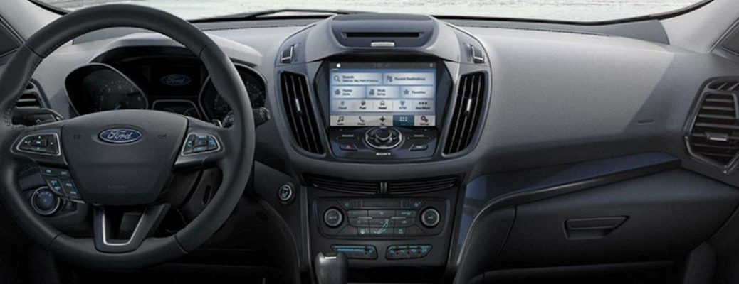 Steering wheel and dashboard of Ford SUV to illustrate new tech features