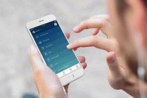 Man using fingers to use FordPass app on smartphone