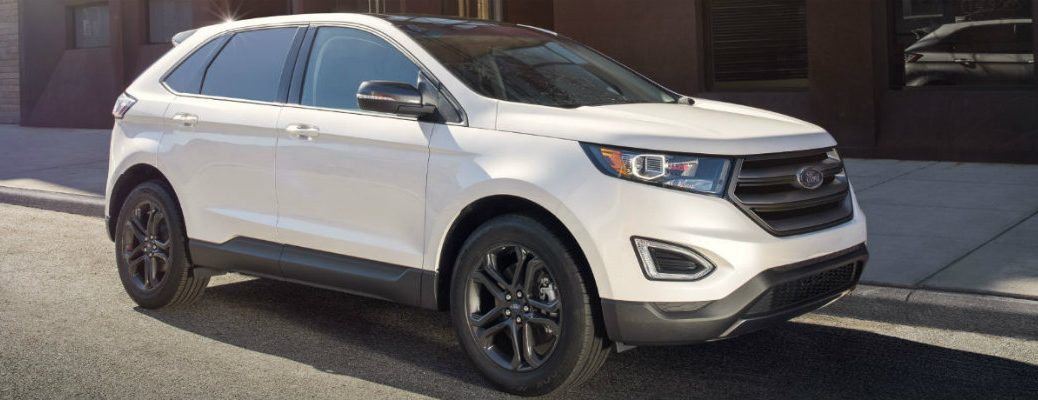 White 2018 Ford Edge parked on city street curb