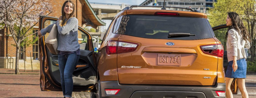 Two girls exiting 2018 Ford EcoSport in daytime