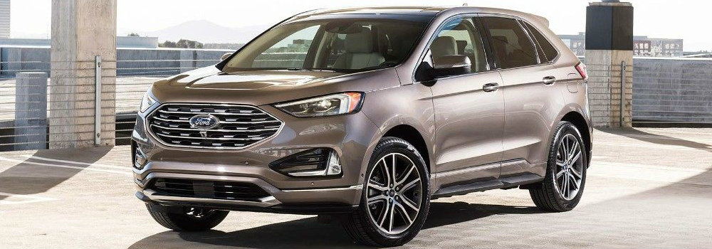 Tan 2019 Ford Edge parked in lot