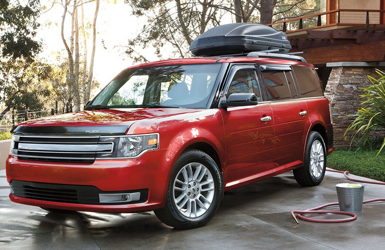Red 2018 Ford Flex parked on street