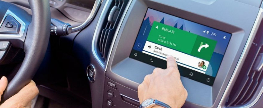 Finger operating Android Auto inside Ford vehicle