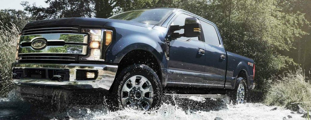 Blue Jeans 2019 Ford Super Duty driving through wet brook