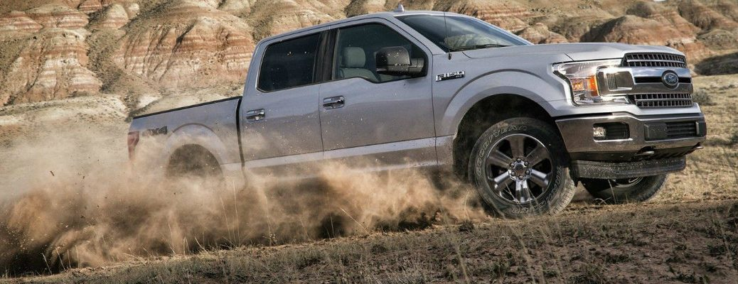 Profile view of 2019 Ford F-150 scaling up desert hill
