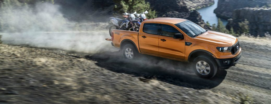 Orange 2019 Ford Ranger driving on mountainous road