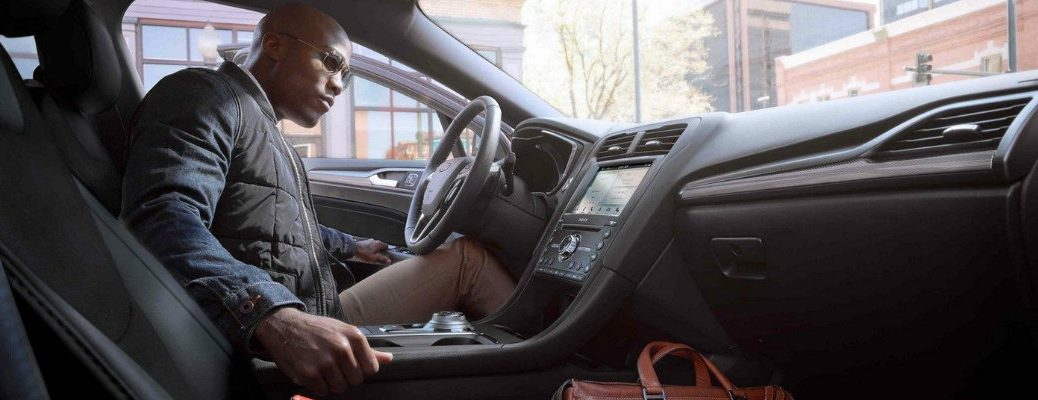 Man Using Push Button Start Inside  Ford Fusion