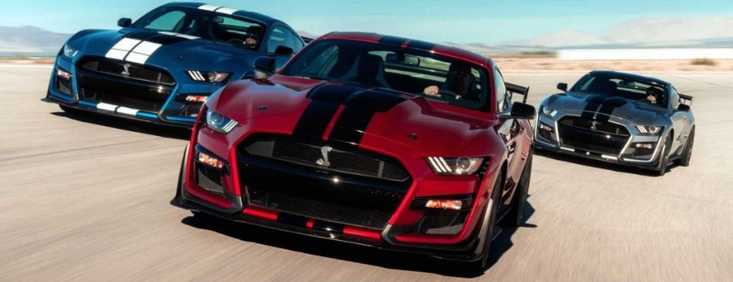 Three Ford Mustang Shelby models driving on track