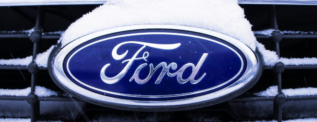 Snow covering Ford vehicle nameplate