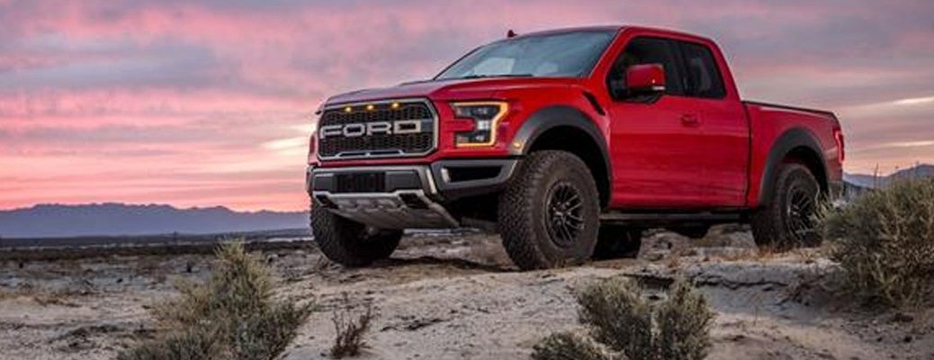 Red 2019 Ford F-150 Raptor parked overlooking desert