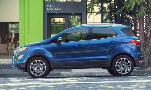 Blue 2019 Ford EcoSport parked on city curb