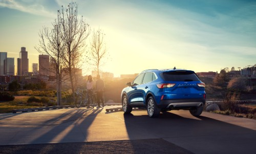 Rear shot of 2020 Ford Escape overlooking city at sunset