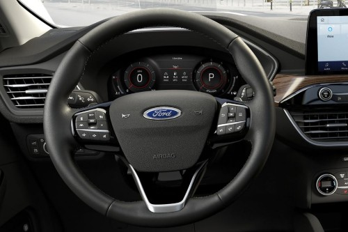 Steering wheel and centre information display inside 2020 Ford Escape