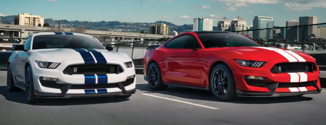 Two 2019 Ford Mustang Shelby GT350 models driving on highway