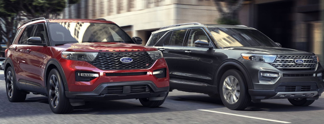 Two 2020 Ford Explorer models driving on busy city street