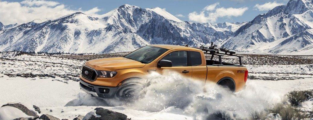 Orange 2019 Ford Ranger driving through snow