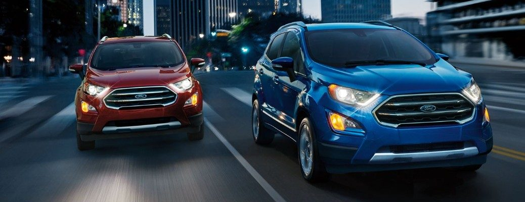 Two 2019 Ford EcoSport models driving on dark highway