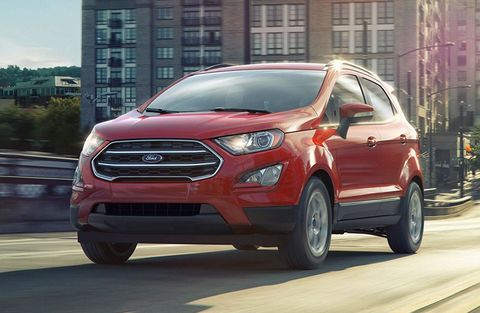 Red 2019 Ford EcoSport driving on city road