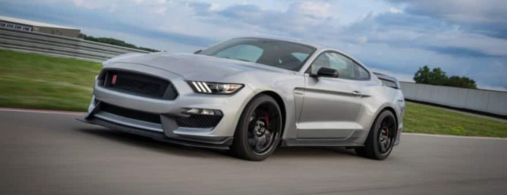 Silver 2020 Ford Mustang Shelby GT350R driving on track