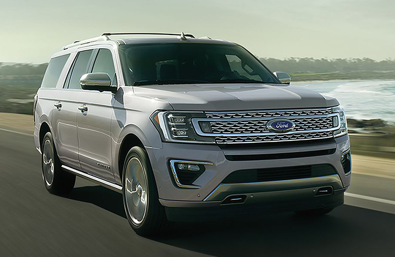 Front view of 2019 Ford Expedition driving on waterfront road