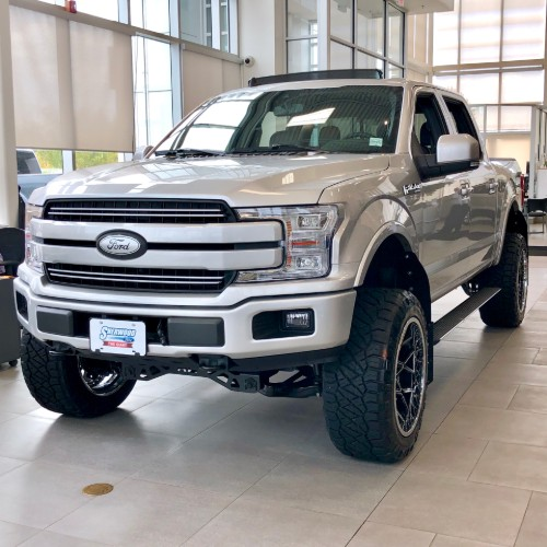White customized Ford F-150 at Sherwood Ford