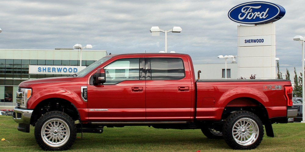 Profile view of red customized Ford F-350 at Sherwood Ford