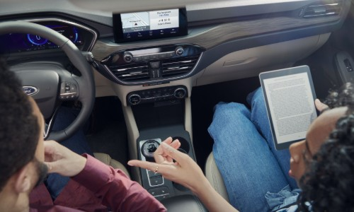 Woman connecting tablet to 2020 Ford Escape