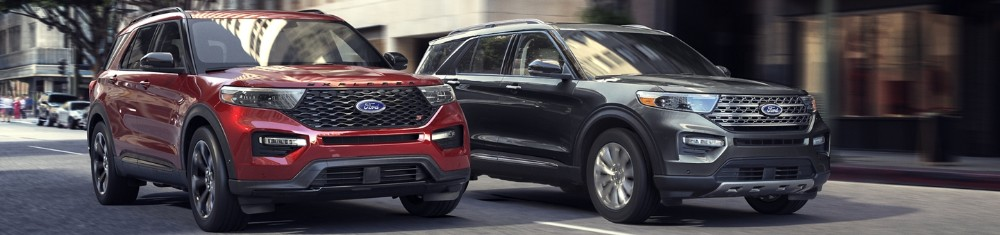 2020 Ford Explorer ST and Hybrid trims driving on city road