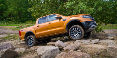 Orange 2019 Ford Ranger driving over rocks