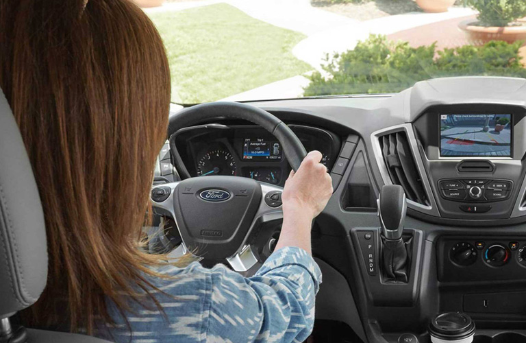 Woman gripping steering wheel of 2020 Ford Transit