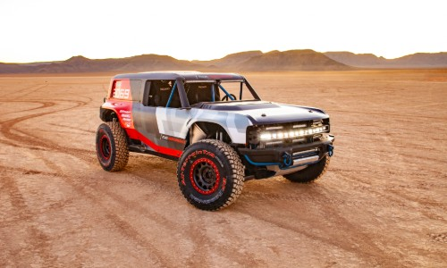 Front view of Ford Bronco R driving through sand