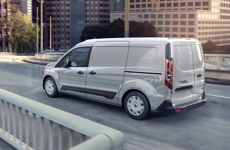 Profile view of white 2020 Ford Transit Connect