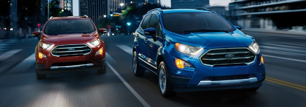 Two 2020 Ford EcoSport models driving on city road at night