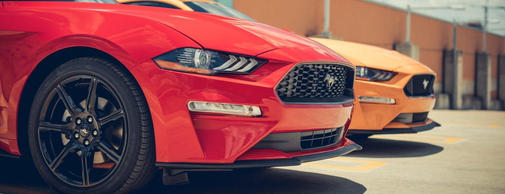 Headlight, grille and pony emblem of Race Red and Orange Fury Mustang