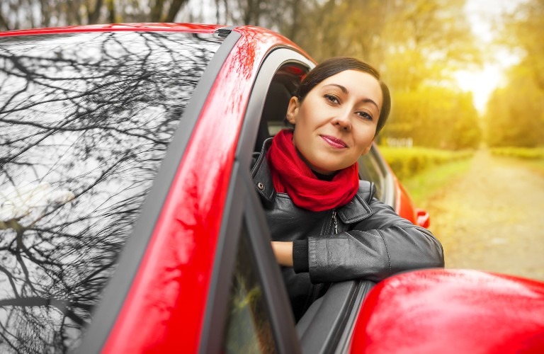 woman in a red car