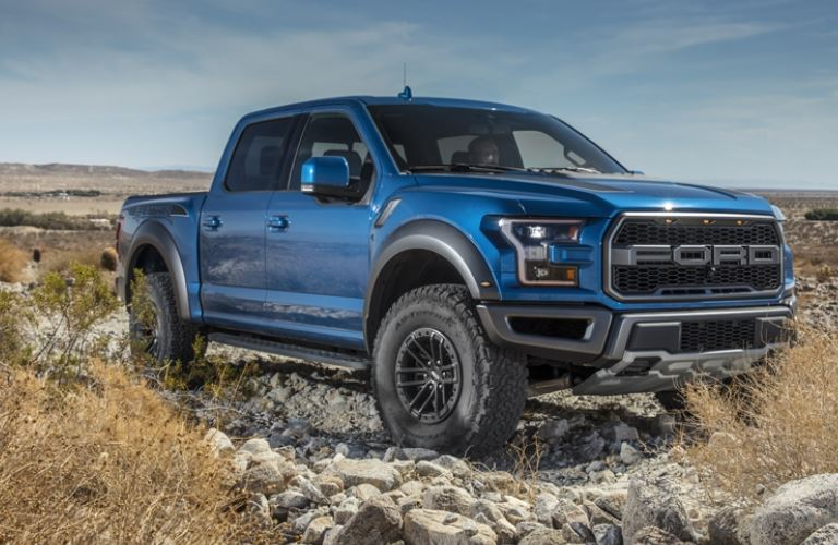 blue 2020 Ford F-150 Raptor side view