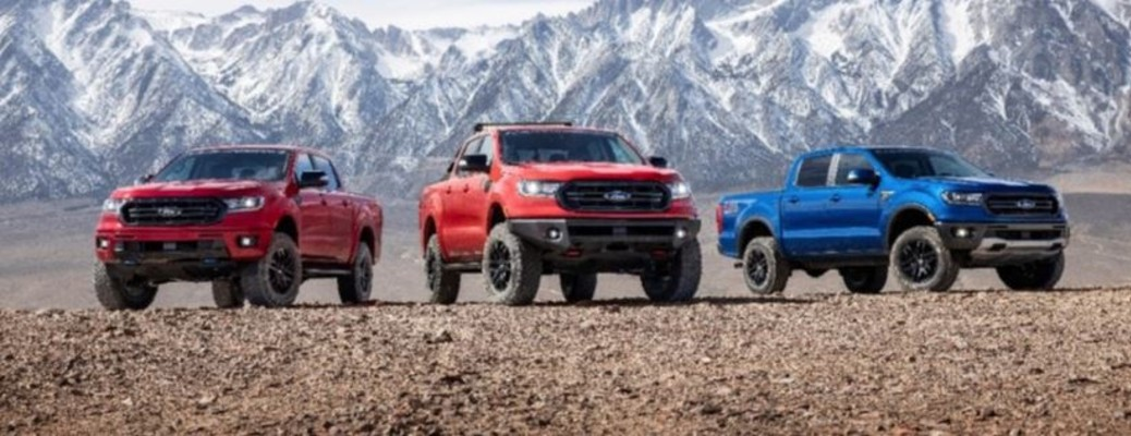 three Ford Ranger trucks in a row