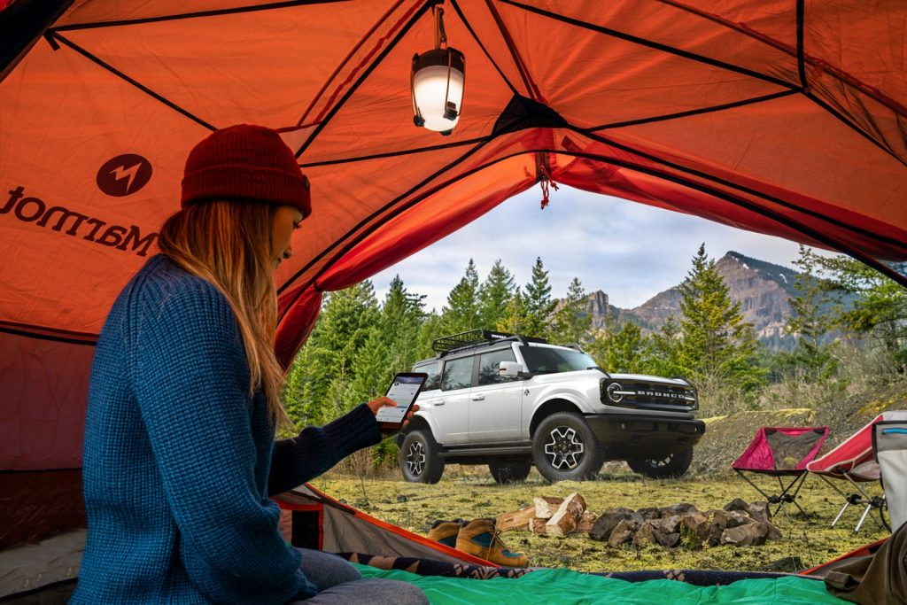 2021 Ford Bronco and a woman in a tent