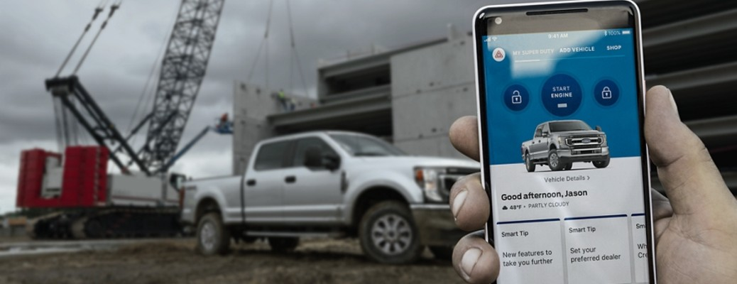 2020 Ford Super Duty with a hand and phone