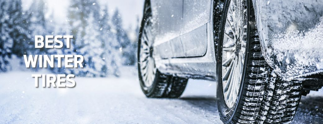 Car Winter Tires on Snowy Road