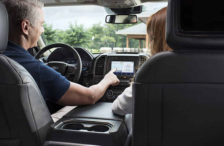 two people in a 2020 Ford Expedition