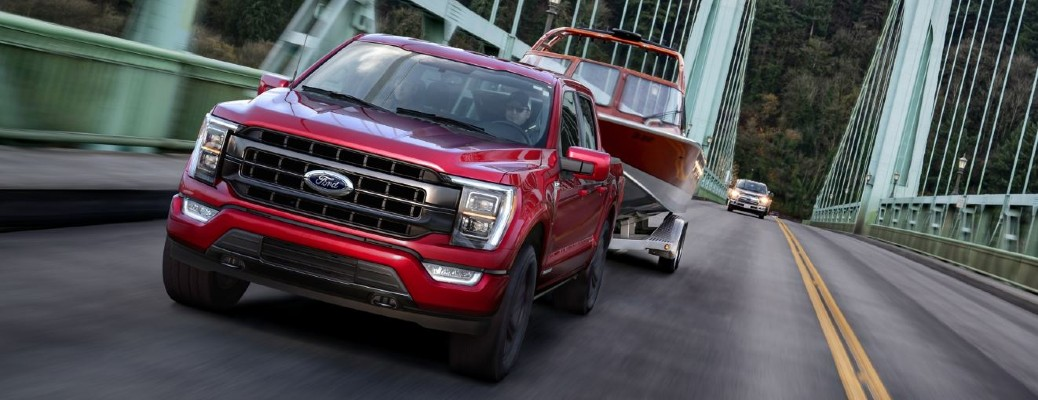 a red 2021 Ford F-150 facing front