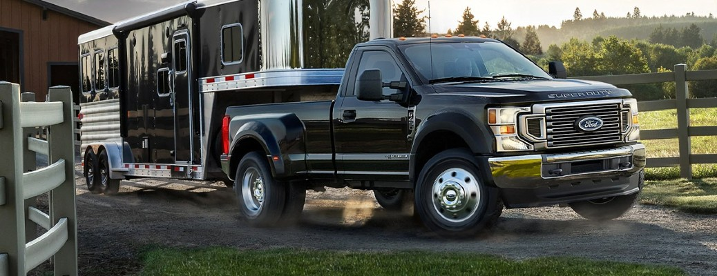 2021 Ford Super Duty pickup truck towing a trailer