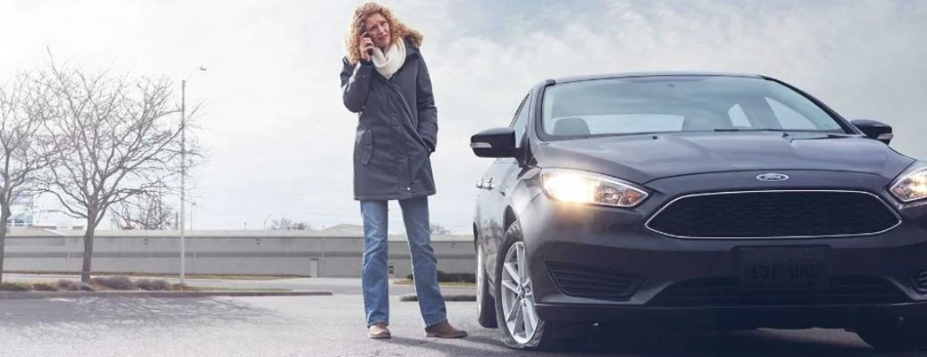 Ford Roadside Assistance in Canada image of woman by a car