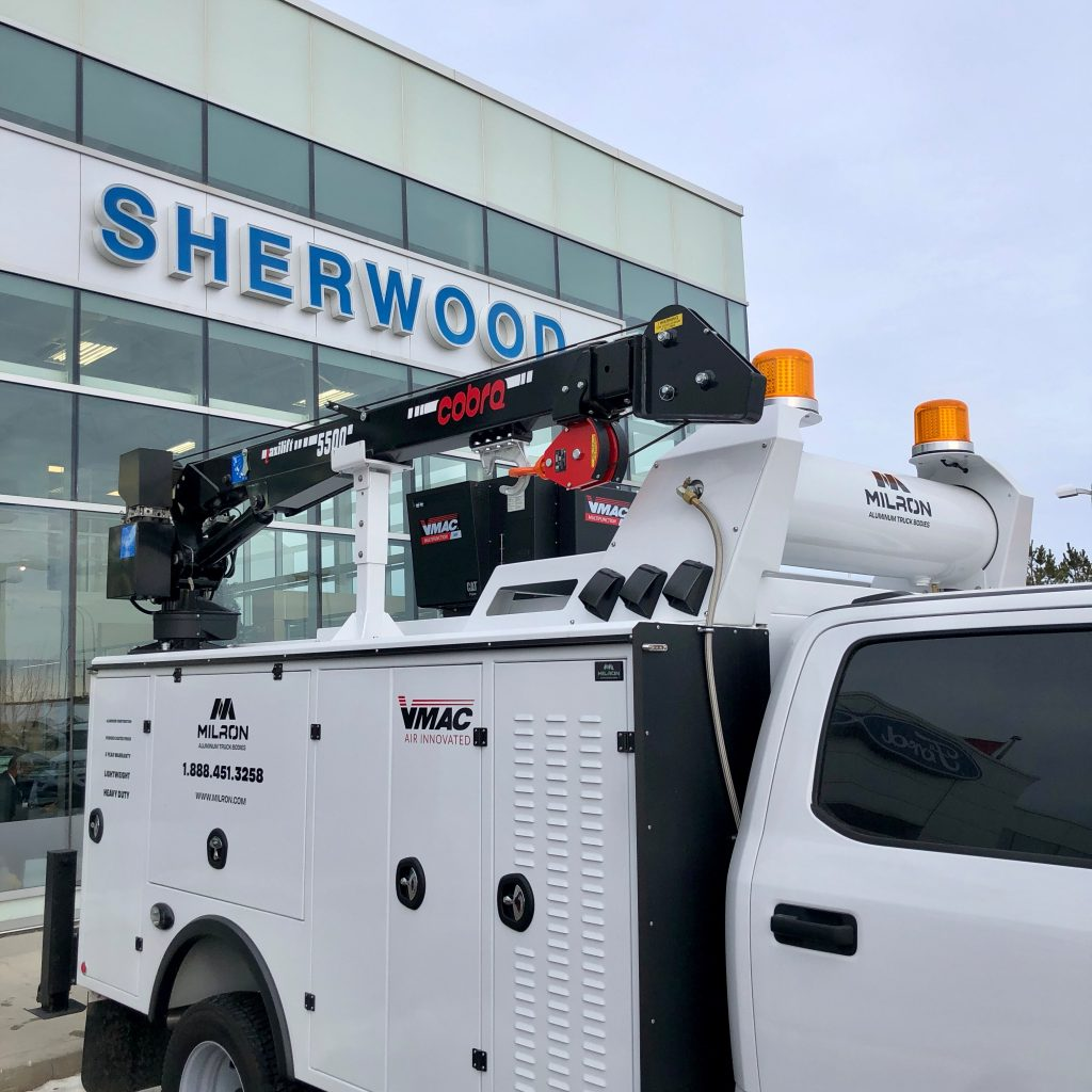 custom 2020 Ford F-550 crane truck with Sherwood logo in background