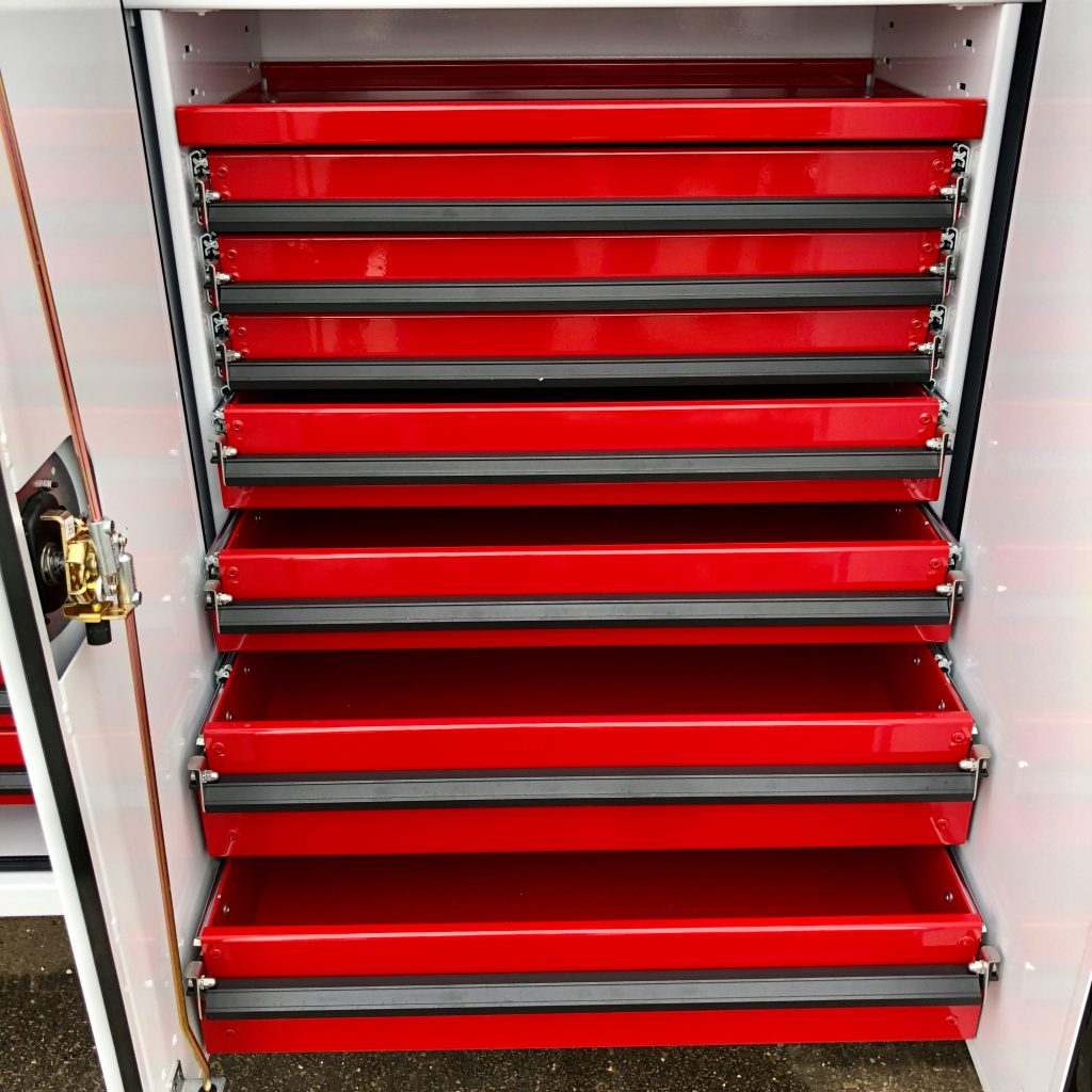 custom 2020 Ford F-550 crane truck view of different red drawers